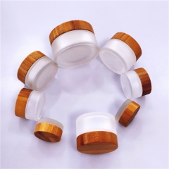 Cosmetic glass cream jar with bamboo lid